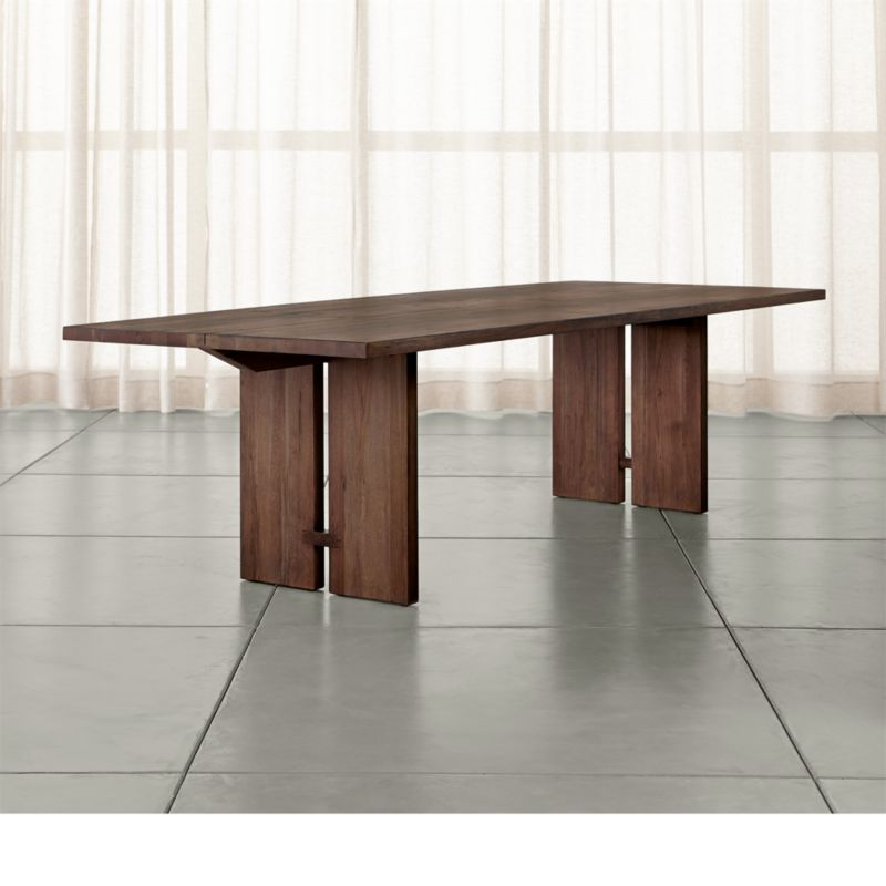 Our Monarch dining collection is handcrafted using centuries-old techniques in a modern way. Rare lengths of solid walnut chosen for their beautiful cathedral graining, are united on top with traditional wood-on-wood butterfly joinery without using nails or screws. <NEWTAG/><ul><li>Solid walnut</li><li>Shiitake finish and water-based polyurethane topcoat</li><li>Traditional wood-on-wood joinery</li><li>Seats 10</li><li>Made in China</li></ul>