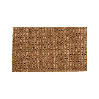 Triple fiber construction adds a design dimension to this natural doormat. Coarse, durable coir with its inherent boot-scraping properties is woven with jute and polypropylene for a tonal fiber look.
