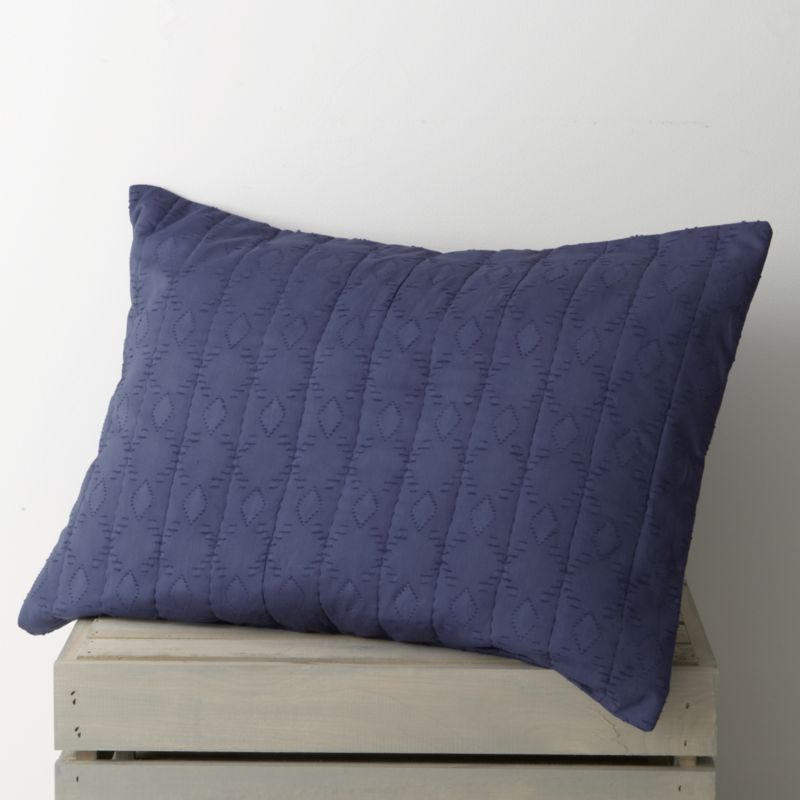 Brilliant blue, gathered in hand-quilted rows and patterned with diamonds, lending rich texture to soft cotton and cotton voile. Sham reverses to a cotton voile with a generous overlapping closure. Duvet inserts and bed pillows also available.<br /><br /><NEWTAG/><ul><li>100% cotton</li><li>Machine wash cold, tumble dry low</li><li>Do not iron</li><li>Made in India</li></ul>