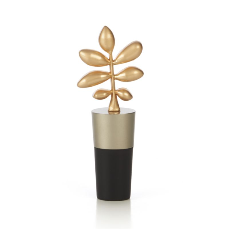 Elegant bottle stopper dresses up wine bottles with a sculptural, gold-toned oak leaf ornament topper. Rubber stopper seals and keeps out air to keep opened wine fresh.<br /><br /><NEWTAG/><ul><li>Zinc alloy topper with matte gold finish</li><li>Rubber stopper</li><li>Made in China</li></ul>