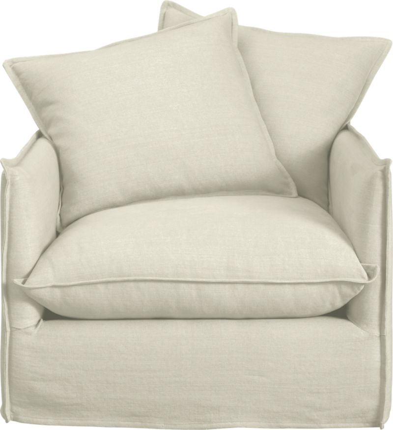 """Slipcover for Oasis Chair is 100% linen tailored fresh with a fashionable flanged edge and casual drape at the floor.<br /><br />Additional <a href=""""http://crateandbarrel.custhelp.com/cgi-bin/crateandbarrel.cfg/php/enduser/crate_answer.php?popup=-1&p_faqid=125&p_sid=DMUxFvPi"""">slipcovers</a> available below and through stores featuring our Furniture Collection.<br /><br />After you place your order, we will send a fabric swatch via next day air for your final approval. We will contact you to verify both your receipt and approval of the fabric swatch before finalizing your order.<br /><br /><NEWTAG/><ul><li>100% linen</li><li>Dry cleaning recommended</li><li>Made in North Carolina, USA of domestic and imported materials</li></ul>"""