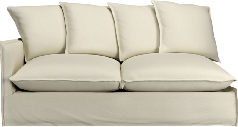 "Slipcover for Oasis Left Arm Sofa is 100% linen tailored fresh with a fashionable flanged edge and casual drape at the floor.<br /><br />Additional <a href=""http://crateandbarrel.custhelp.com/cgi-bin/crateandbarrel.cfg/php/enduser/crate_answer.php?popup=-1&p_faqid=125&p_sid=DMUxFvPi"">slipcovers</a> available below and through stores featuring our Furniture Collection.<br /><br />After you place your order, we will send a fabric swatch via next day air for your final approval. We will contact you to verify both your receipt and approval of the fabric swatch before finalizing your order.<br /><br /><NEWTAG/><ul><li>100% linen</li><li>Dry cleaning recommended</li><li>Made in North Carolina, USA</li></ul><br />"