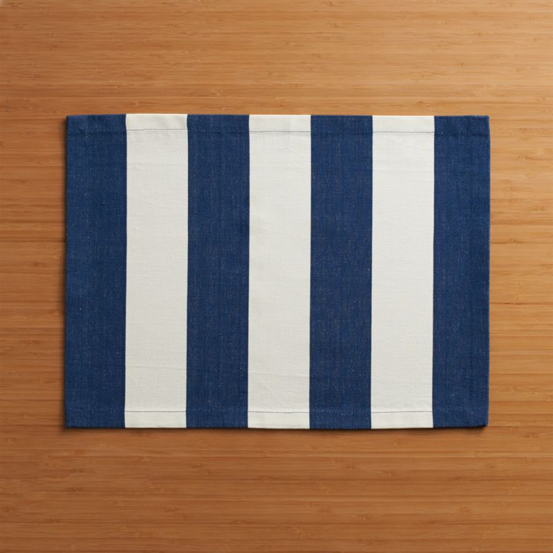 Broad bands of navy and ivory stretch horizontally across modern, sophisticated hand-dyed cotton placemat.<br /><br /><NEWTAG/><ul><li>Handcrafted</li><li>100% cotton</li><li>Machine wash, reshape and dry flat; warm iron as needed</li><li>Oversized to allow for shrinkage</li><li>Made in India</li></ul>