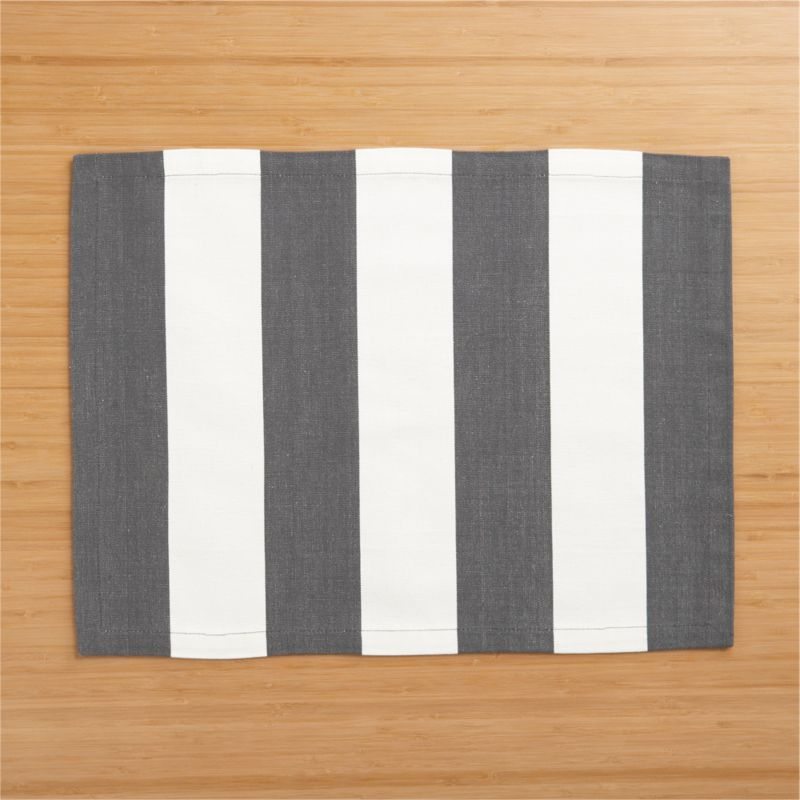 Broad bands of grey and ivory stretch horizontally across modern, sophisticated hand-dyed cotton placemat.<br /><br /><NEWTAG/><ul><li>Handcrafted</li><li>100% cotton</li><li>Machine wash, reshape and dry flat; warm iron as needed</li><li>Oversized to allow for shrinkage</li><li>Made in India</li></ul>