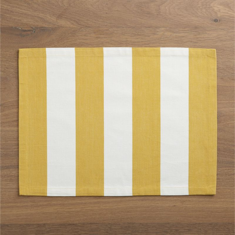 Broad bands of mustard and ivory stretch horizontally across modern, sophisticated hand-dyed cotton placemat.<br /><br /><NEWTAG/><ul><li>Handcrafted</li><li>100% cotton</li><li>Dry clean placemat or machine wash separately in cold water on gentle cycle, reshape and dry flat, iron on high</li><li>Do not tumble dry placemat</li><li>Oversized to allow for shrinkage</li><li>Made in India</li></ul>