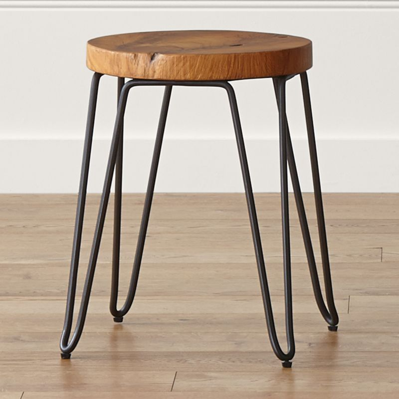 Cross-sectioned from discarded teak root, the Origin dining stool reveals and preserves the natural rings, knots and live edge that tell a tree's unique story. This organic, versatile stool can be used for seating at a dining table or as a side table. <NEWTAG/><ul><li>Teak root with clear lacquer topcoat</li><li>Rod iron base with dark brown finish</li><li>Each piece is unique and will display characteristics of natural wood</li><li>Expansion and contraction of wood may occur</li><li>Seat diameter will vary</li><li>Made in Indonesia</li></ul><br />