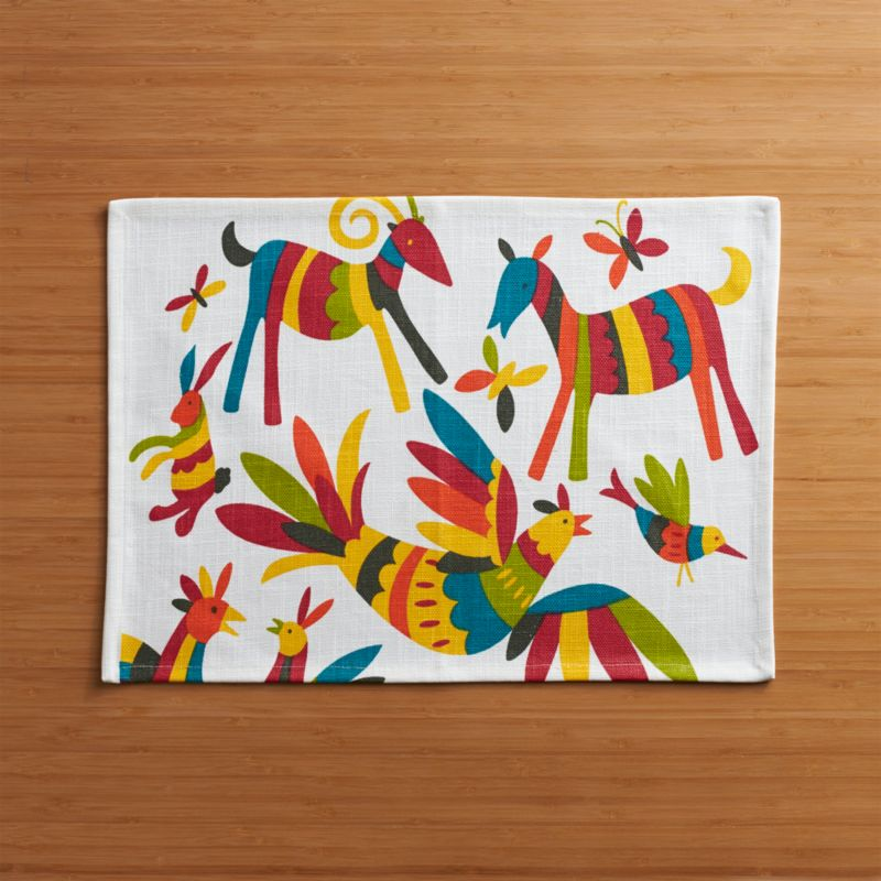 The signature style of Mexico's Otomi artisans gives us a vibrant, multi-colored menagerie, dancing across a white cotton placemat.<br /><br /><NEWTAG/><ul><li>100% cotton with acrylic coating</li><li>Clean with a damp cloth</li><li>Made in India</li></ul>