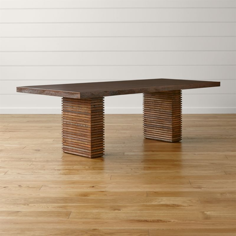 Naturally aged, reclaimed peroba wood is artfully repurposed in this Zen-meets-Prairie-Style dining table. The rare, exotic wood is reclaimed from the siding and floors of old buildings in Brazil no longer in use, then restored and handcrafted to create the table's dynamic presence. <NEWTAG/><ul><li>Reclaimed peroba wood, engineered wood and mahogany veneer</li><li>Top has java brown finish with water-based clear lacquer topcoat</li><li>Each piece is unique due to the natural aging process of peroba wood</li><li>Seats 8</li><li>Made in Indonesia</li></ul><br />
