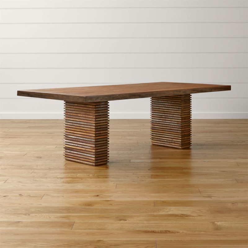 A modern table with a rich history, the Paloma II table is the story of timber reclamation from around the world. Its distinctive base of precision-cut strips is handcrafted of peroba wood reclaimed from homes in Brazil no longer in use. In organic contrast is a top veneer of Australian ironbark hardwood, reclaimed from Brisbane's historic Hornibrook Highway Bridge circa 1935. <NEWTAG/><ul><li>Reclaimed peroba wood legs</li><li>Reclaimed Australian hardwood veneered top</li><li>Clear water-based lacquer finish</li><li>Each piece is unique due to the natural aging process of reclaimed woods</li><li>Seats 8</li><li>Made in Indonesia</li></ul><br />