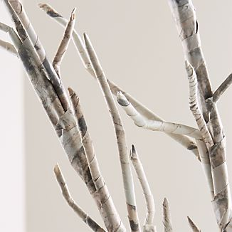 Stylized tree twigs branch out in hand-wrapped in paper for a natural accent with artisan appeal. Brings the outdoors inside set in a tall vase or bundled with rope or ribbon.