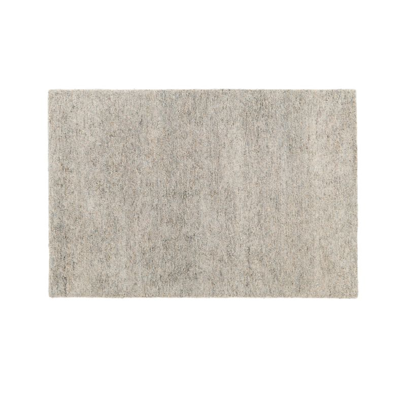 Ample 10x14 rugs feature a soft, lustrous modern shag with a subtle variegated effect achieved by hand-tufting and hand-shearing felted New Zealand wool that has been dyed in tonal neutral hues. Crafted of pure wool, this rug will occasionally shed, especially during the first few months, which is easily managed with regular vacuuming.<br /><br />Order 10x14 rugs online and arrange a convenient warehouse pickup or delivery.<br /><br /><NEWTAG/><ul><li>100% New Zealand wool</li><li>Cotton-latex backing</li><li>Rug pad recommended</li><li>Professional cleaning recommended</li><li>Shedding will occur; vacuum weekly to manage</li><li>To avoid damage to your rug, always vacuum with the beater bar off, using a high pile setting</li><li>Made in India</li></ul>