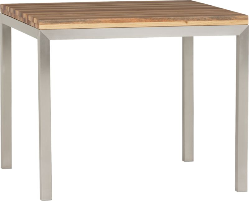 Start with a great base. Top it off with an amazing top. Voila—the perfect table. Stainless-steel frame with a contemporary matte finish supports with clean simple lines. Gorgeous wood top is handcrafted from an eclectic mix of reclaimed hardwoods native to Australia. Precisely hewn planks compose a banded spectrum of warm tones and unique textures. Finished smooth with tung tree oil and natural lacquer. Seats four.<br /><br /><NEWTAG/><ul><li>Stainless-steel base with matte finish</li><li>100% reclaimed wood tabletop with tung tree oil and lacquer finish</li><li>Seats four</li><li>Do not leave spills unattended</li><li>Wipe with damp cloth and dry</li><li>Made in Indonesia and China</li></ul>