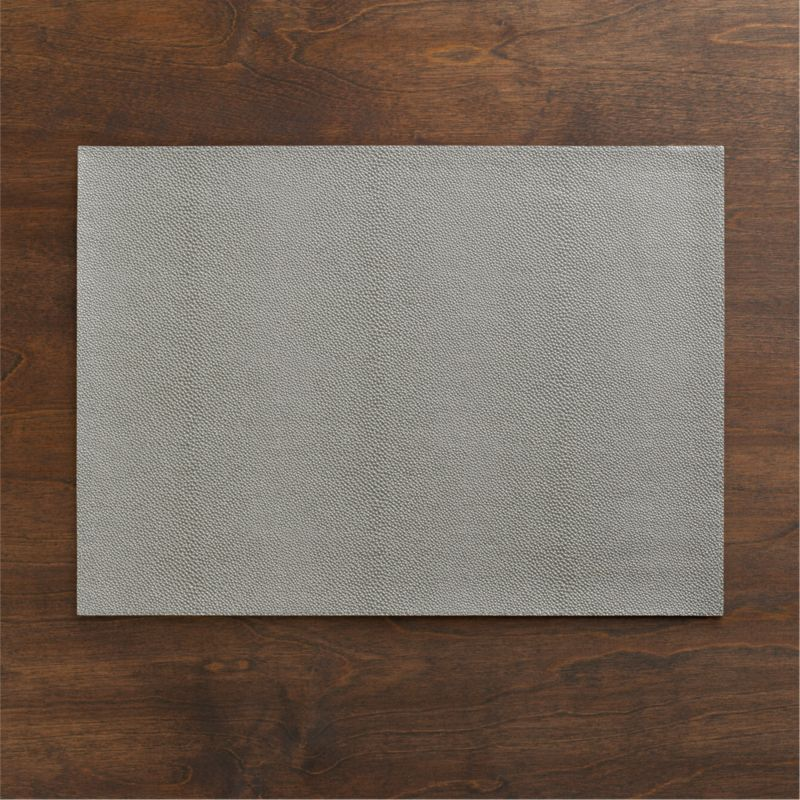 Pebbled vinyl placemat decks out in cool grey with the look of richly grained leather. Easy-care option in a smart neutral dresses up or down.<br /><br /><NEWTAG/><ul><li>100% PVC with flocked backing</li><li>Clean with damp cloth</li><li>Made in Turkey</li></ul>