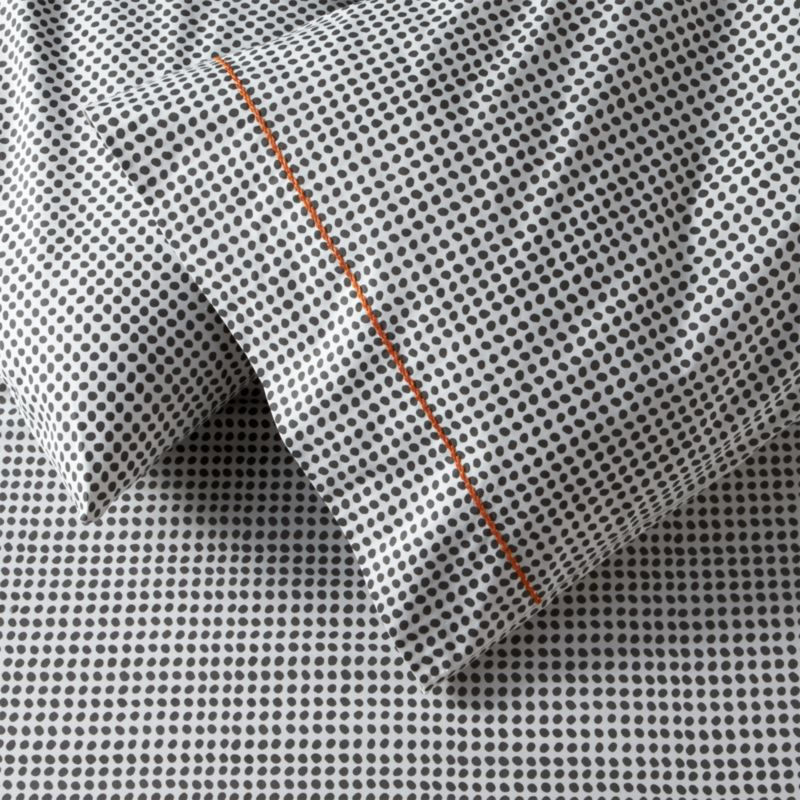 Traditional block-printed fabric emerges as a new neutral, pebbled with casual polka dots that play pattern and solid with a wide range of bedding. Hand-blocked pattern is printed on soft cotton with a single line of hand-embroidered chain stitch. Bed pillows also available.<br /><br /><NEWTAG/><ul><li>Handcrafted</li><li>100% cotton percale</li><li>200-thread-count</li><li>Machine wash, tumble dry low</li><li>Made in India</li></ul>