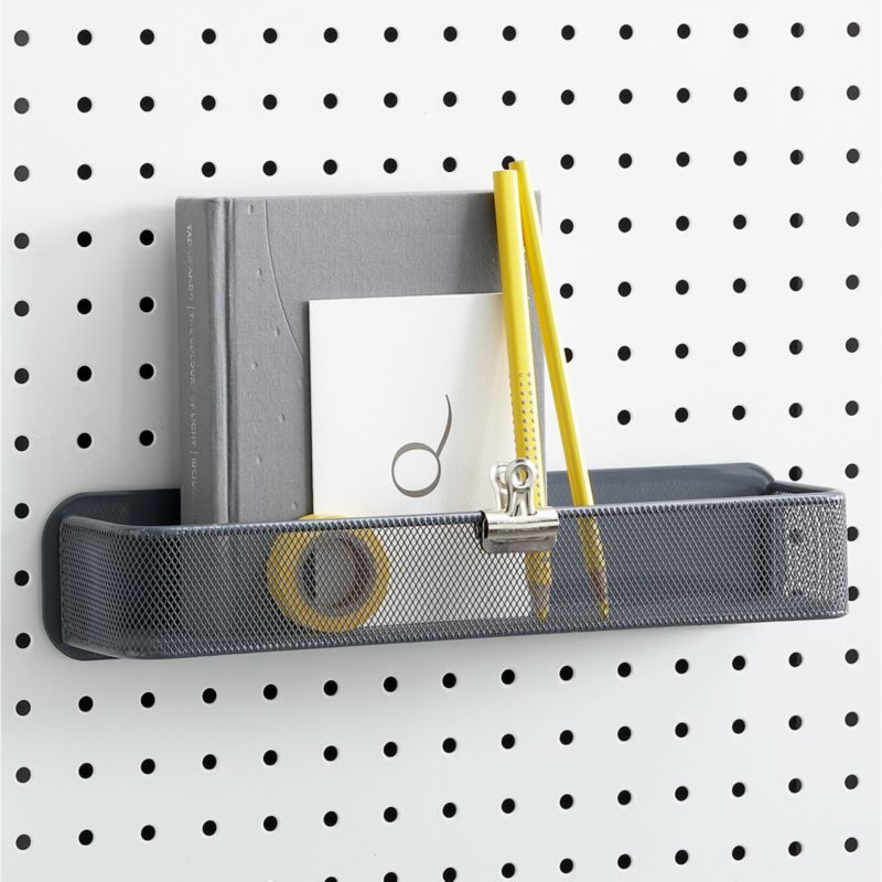 Hook it, hang it, have it all in view, all at your fingertips. Carefully crafted of heavy-duty iron, our system of white perforated boards and accessories helps you achieve meticulous order in any room that needs tidying. Add this foot-long mesh bin to any of our pegboards to contain office or craft supplies, keys and sunglasses, tools and more.<br /><br /><NEWTAG/><ul><li>From three by three® of Seattle</li><li>100% iron</li><li>Powdercoat finish</li><li>Clean with a dry cloth</li><li>Made in China</li></ul>