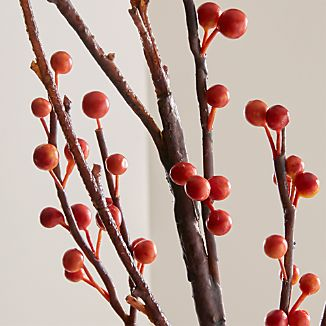 "Bright little ""berries"" on a rustic ""branch"" stand almost five feet tall for a dramatic seasonal crafted botanical."