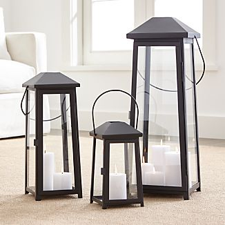 "Statuesque Petaluma takes the classic paned glass lantern to new heights. Tall, rectangular frame rises to a simple silhouette black iron to let the light shine indoors or out. Three sizes at a great price triple the impact of this modern classic.IronGlassWipe clean with damp clothStore inside during inclement weatherSmall and medium accommodate up to 3""-diameter pillar candle, sold separatelyLarge recommended use with 6""dia.x12"" outdoor flameless pillar candle, sold separatelyMade in India"
