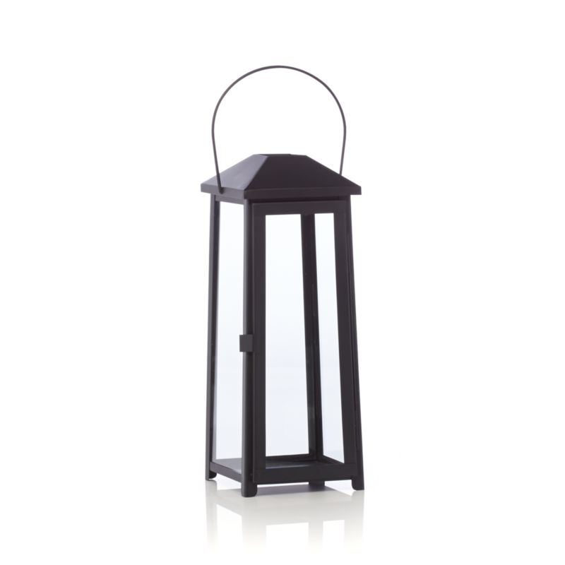 """Statuesque Petaluma takes the classic paned glass lantern to new heights. Tall, rectangular frame rises to a simple silhouette black iron to let the light shine indoors or out. Three sizes at a great price triple the impact of this modern classic.<br /><br /><NEWTAG/><ul><li>Iron</li><li>Glass</li><li>Wipe clean with damp cloth</li><li>Store inside during inclement weather</li><li>Accommodates up to 3""""-diameter pillar candle, sold separately</li><li>Made in India</li></ul><br />"""