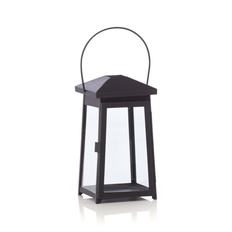"Statuesque Petaluma takes the classic paned glass lantern to new heights. Tall, rectangular frame rises to a simple silhouette black iron to let the light shine indoors or out. Three sizes at a great price triple the impact of this modern classic.<br /><ul><li>Iron</li><li>Glass</li><li>Wipe clean with damp cloth</li><li>Store inside during inclement weather</li><li>Accommodates up to 3""-diameter pillar candle, sold separately</li><li>Made in India</li></ul><br /><NEWTAG/>"
