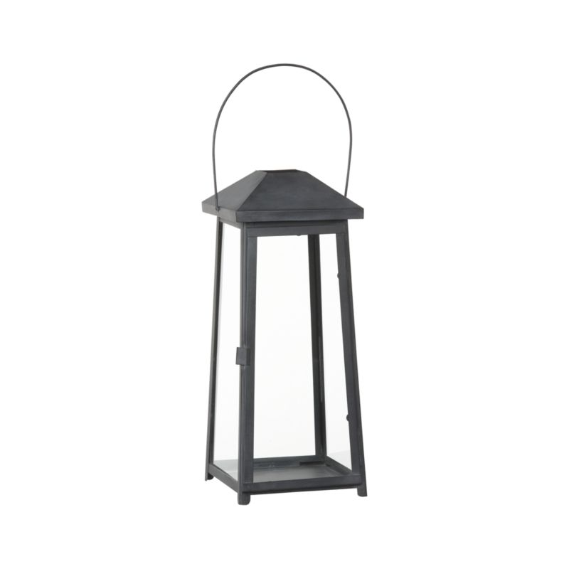 "Statuesque Petaluma takes the classic paned glass lantern to new heights. Tall, rectangular frame rises to a simple silhouette in grey antique-finished iron to let the light shine indoors or out.<br /><br /><NEWTAG/><ul><li>Iron with grey antique finish</li><li>Glass</li><li>Wipe clean with damp cloth</li><li>Store inside during inclement weather</li><li>Accommodates up to 4""-dia. pillar candle, sold separately</li><li>Made in India</li></ul>"