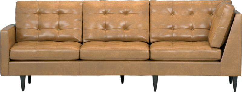 It was the most familiar furniture shape of the 1960s. And now it's coming back to a living room near you as a luxe leather sectional. This time around, it has tufted and buttoned cushions for a more classic, tailored look that sits deep and firm, but lets you slouch in comfort. Petrie is authentically styled light and lean in top-grain, full-aniline leather with slim track arms and trim hardwood legs stained a dark ebony finish called deco.<br /><br />After you place your order, we will send a leather swatch via next day air for your final approval. We will contact you to verify both your receipt and approval of the leather swatch before finalizing your order.<br /><br /><NEWTAG/><ul><li>Eco-friendly construction</li><li>Certified sustainable, kiln-dried hardwood frame</li><li>Seat cushions are soy-based polyfoam with fiber wrapped in downproof ticking</li><li>Back cushions are a blend of virgin and recycled fibers</li><li>Upholstered in top-grain, full-aniline leather</li><li>Sinuous wire spring suspension</li><li>Button-tufted detail</li><li>Benchmade</li><li>See additional frame options below</li><li>Made in Virginia, USA of domestic and imported materials</li></ul>