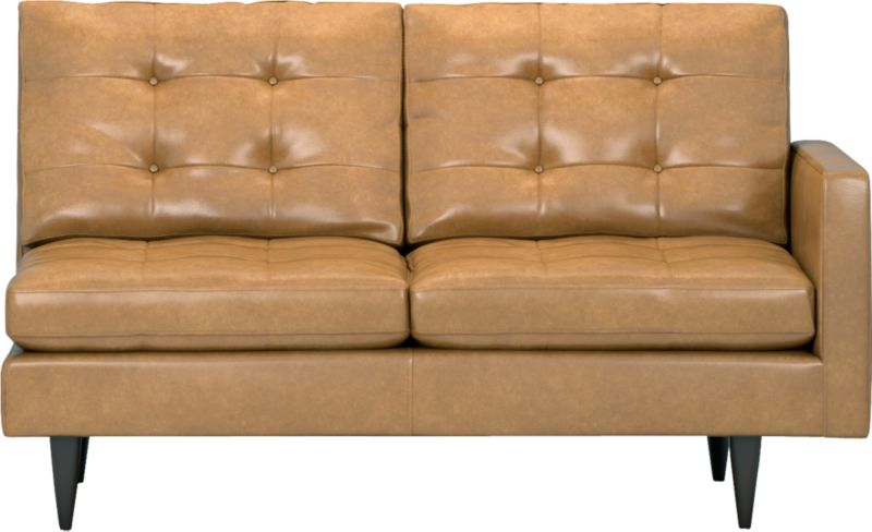 It was the most familiar furniture shape of the 1960s. And now it's coming back to a living room near you as a luxe leather sectional. This time around, it has tufted and buttoned cushions for a more classic, tailored look that sits deep and firm, but lets you slouch in comfort. Petrie is authentically styled light and lean in top-grain, full-aniline leather with slim track arms and trim hardwood legs stained a dark ebony finish called deco.<br /><br />After you place your order, we will send a leather swatch via next day air for your final approval. We will contact you to verify both your receipt and approval of the leather swatch before finalizing your order.<br /><br /><NEWTAG/><ul><li>Eco-friendly construction</li><li>Certified sustainable, kiln-dried hardwood frame</li><li>Seat cushions are soy-based polyfoam with fiber wrapped in downproof ticking</li><li>Back cushions are a blend of virgin and recycled fibers</li><li>Upholstered in top-grain, full-aniline leather</li><li>Sinuous wire spring suspension</li><li>Button-tufted detail</li><li>Benchmade</li><li>See additional frame options below</li><li>Made in Virginia, USA</li></ul>