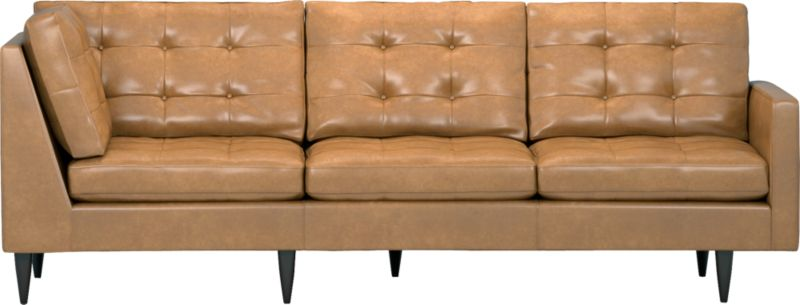 It was the most familiar furniture shape of the 1960s. And now it's coming back to a living room near you as a luxe leather sectional. This time around, it has tufted and buttoned cushions for a more classic, tailored look that sits deep and firm, but lets you slouch in comfort. Petrie is authentically styled light and lean in top-grain, full-aniline leather with slim track arms and trim hardwood legs stained a dark ebony finish called deco.<br /><br /><NEWTAG/>After you place your order, we will send a leather swatch via next day air for your final approval. We will contact you to verify both your receipt and approval of the leather swatch before finalizing your order.<br /><ul><li>Eco-friendly construction</li><li>Certified sustainable, kiln-dried hardwood frame</li><li>Seat cushions are soy-based polyfoam with fiber wrapped in downproof ticking</li><li>Back cushions are a blend of virgin and recycled fibers</li><li>Upholstered in top-grain, full-aniline leather</li><li>Sinuous wire spring suspension</li><li>Button-tufted detail</li><li>Benchmade</li><li>See additional frame options below</li><li>Made in Virginia, USA of domestic and imported materials</li></ul>