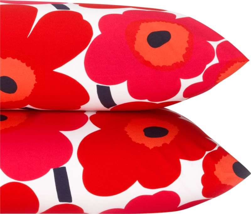 """Designed in 1964 by Maija Isola, the Unikko (""""poppy"""") design has been the most popular Marimekko print since its introduction. Challenging the common notion of decorative florals, Unikko broke from tradition with its creative pop art interpretation in bold, simplified pattern and bright color. Reproduced in infinite color combinations over its 47-year history, the pattern remains current while symbolizing the free spirit of its designer and those who admire it. Pieni Unikko is scaled between the original Unikko and the Mini-Unikko patterns. Bed pillows also available.<br /><br /><NEWTAG/><ul><li>Pattern designed by Maija Isola and Kristina Isola; 1964/2000</li><li>100% cotton percale</li><li>300-thread-count</li><li>Machine wash cold</li><li>Made in Mexico</li></ul>"""