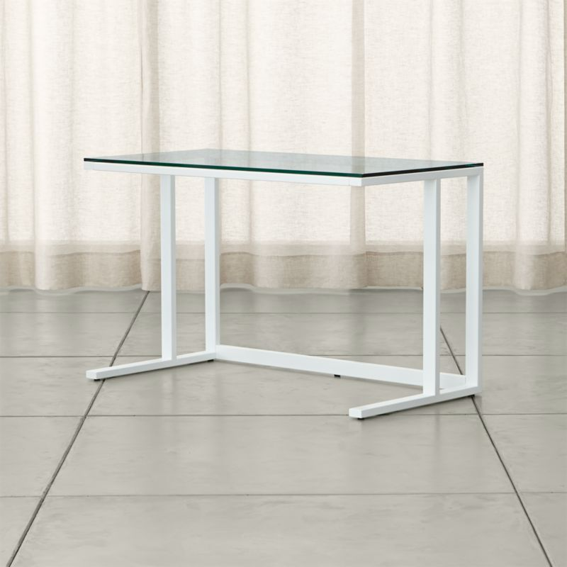 Defined by its industrial mix of glass and steel with modern angles, Pilsen is our urban-inflected architectural collection at a smart value. This desk's glass surface floats over a minimalist frame of rectangular iron tubing finished in high-gloss white. <NEWTAG/><ul><li>Iron tube frame with high-gloss white powdercoat finish</li><li>Tempered glass top</li><li>Levelers</li><li>Designed and tested for use in commercial spaces</li><li>Made in China</li></ul><br />