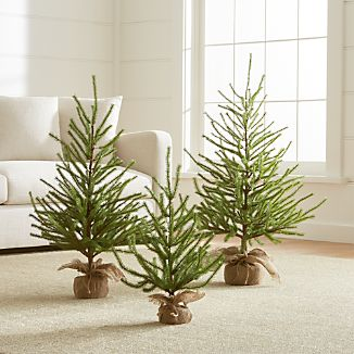 True-to-nature pine tree holiday decor graces the table, hearth or foyer with the beauty of nature, without shedding or watering. Each stately rendition of the real thing sprouts graceful boughs and a rustic burlap-wrapped base. Leave unadorned for a natural look, dress up with small ornaments or create a woodland setting with multiple trees.PVC, wood, iron and burlapIndoor use onlyMade in China