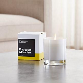 A flicker of fragrance to renew home and spirit. Our exclusive collection of handpoured, soy-blend candles brings together unique scent pairings to express your style and mood. The aromas of sweet pineapple and grassy cilantro mingle with orange, green apple, sweet honeysuckle, huckleberry, vanilla, vetiver and Egyptian musk.