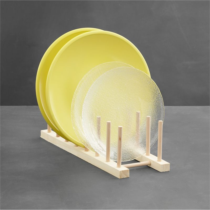 The same natural wood plate racks displayed in our stores are now available to use at home. Display a collection of favorite plates, or simply get your china cupboard organized. Two sizes available (see Small below).<br /><br /><NEWTAG/><ul><li>Natural wood with seven slots</li><li>Easy peg assembly</li><li>Made in Taiwan</li></ul>