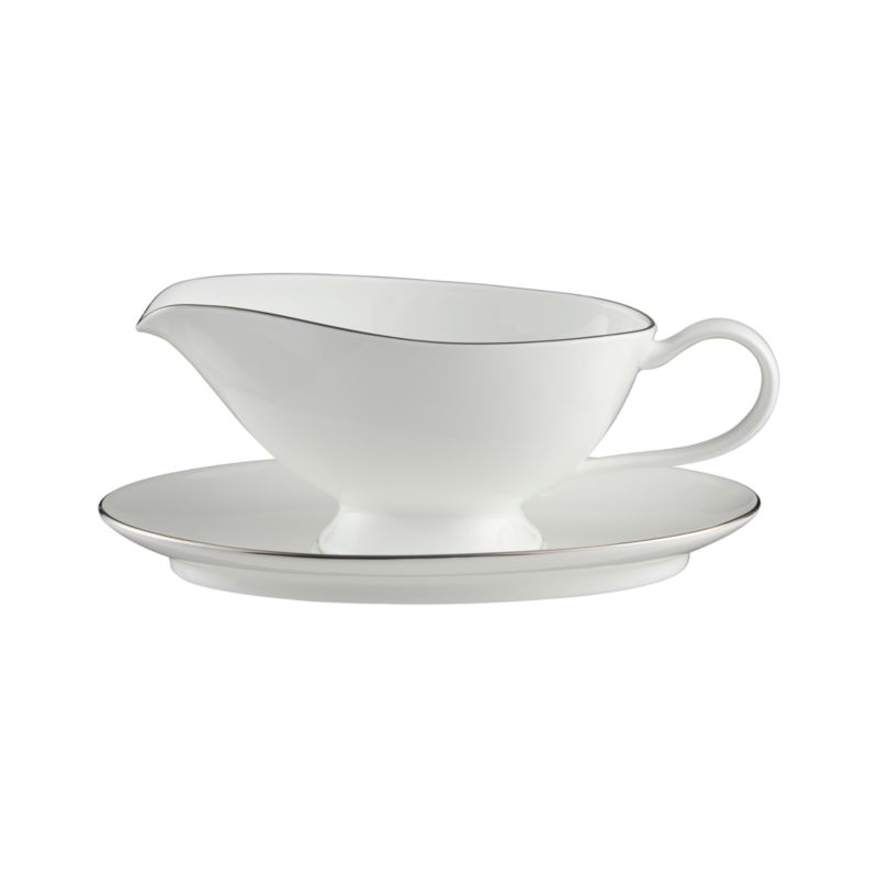 Fine platinum bands rim this refined serving piece in beautiful white bone china. Simple styling coordinates with a wide variety of dinnerware.<br /><br /><strong>Please note:</strong> This gravy boat with saucer is discontinued. When our current inventory is sold out, it is unlikely we will be able to obtain more.<br /><br /><NEWTAG/><ul><li>Bone china</li><li>Dishwasher-safe</li><li>Made in Japan</li></ul>by Nikko Ceramics<br />