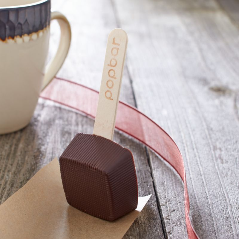 Ingenuity brings us this highly acclaimed dark chocolate dipping stick made with all-natural ingredients and no artificial flavorings. Simply swirl it into a cup of hot milk and it dissolves into a luscious serving of cocoa—if you don't nibble it all first.<br /><br /><NEWTAG/><ul><li>Sugar, cocoa liquor, cocoa butter, milk powder, soya lecithin and vanilla</li><li>1 serving</li><li>Shelf life: 12 months</li><li>Certified kosher</li><li>Produced in a facility that processes nuts</li><li>Gluten-free</li><li>Individually wrapped</li><li>Made in USA</li></ul>