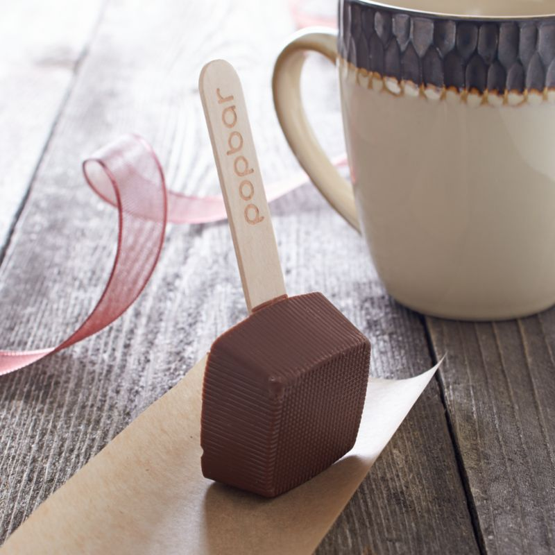 Ingenuity brings us this highly acclaimed milk chocolate dipping stick made with all-natural ingredients and no artificial flavorings. Simply swirl it into a cup of hot milk and it dissolves into a luscious serving of cocoa—if you don't nibble it all first.<br /><br /><NEWTAG/><ul><li>Sugar, cocoa liquor, cocoa butter, milk powder, soya lecithin and vanilla</li><li>1 serving</li><li>Shelf life: 12 months</li><li>Certified kosher</li><li>Produced in a facility that processes nuts</li><li>Gluten-free</li><li>Individually wrapped</li><li>Made in USA</li></ul>
