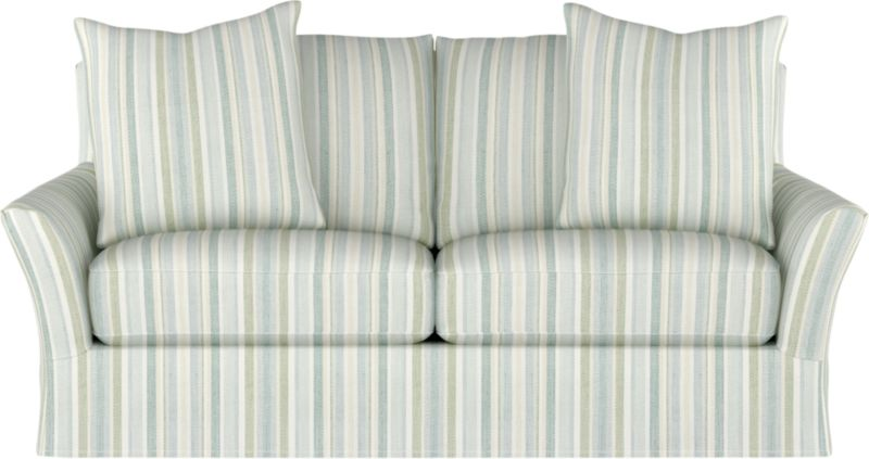 "Modern meets grace in this versatile new classic for living or family room. Slipcover fabric for Portico Apartment Sofa is tumble-washed repeatedly to achieve the soft, lived-in feel of a favorite weekend shirt.<br /><br />Additional <a href=""http://crateandbarrel.custhelp.com/cgi-bin/crateandbarrel.cfg/php/enduser/crate_answer.php?popup=-1&p_faqid=125&p_sid=DMUxFvPi"">slipcovers</a> available below and through stores featuring our Furniture Collection.<br /><br />After you place your order, we will send a fabric swatch via next day air for your final approval. We will contact you to verify both your receipt and approval of the fabric swatch before finalizing your order.<br /><br /><NEWTAG/><ul><li>Linen-cotton blend with topstitch detail</li><li>Machine wash</li></ul>"