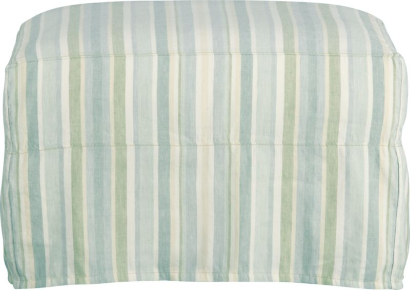 """Modern meets grace in this versatile new classic for living or family room. Slipcover fabric for Portico Ottoman is tumble-washed repeatedly to achieve the soft, lived-in feel of a favorite weekend shirt.<br /><br />Additional <a href=""""http://crateandbarrel.custhelp.com/cgi-bin/crateandbarrel.cfg/php/enduser/crate_answer.php?popup=-1&p_faqid=125&p_sid=DMUxFvPi"""">slipcovers</a> available below and through stores featuring our Furniture Collection.<br /><br />After you place your order, we will send a fabric swatch via next day air for your final approval. We will contact you to verify both your receipt and approval of the fabric swatch before finalizing your order.<br /><br /><NEWTAG/><ul><li>Linen-cotton blend with topstitch detail</li><li>Machine wash</li></ul>"""