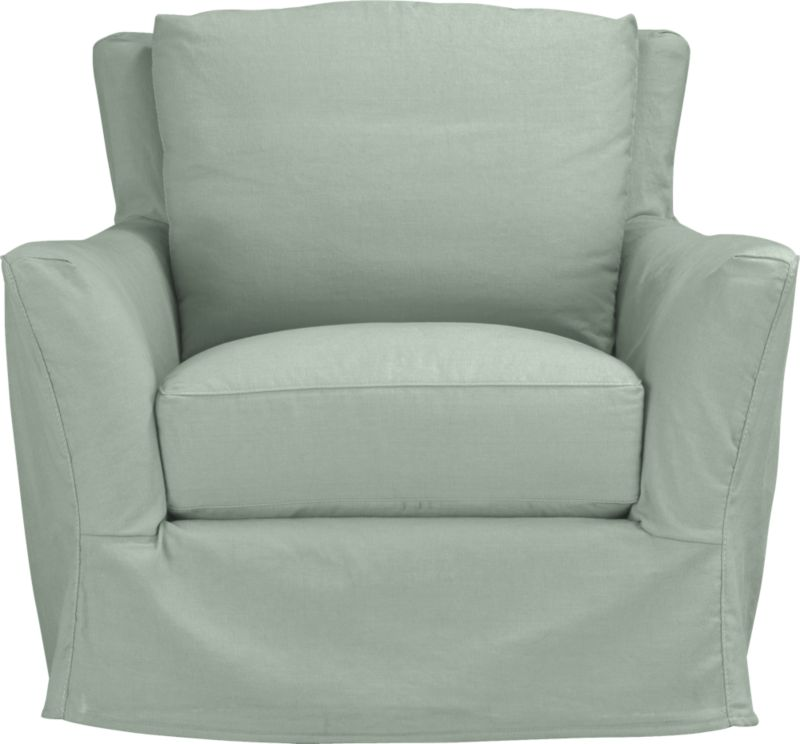 """Modern meets grace in this versatile new classic for living or family room. Unexpected clean, slim arms outwardly gesture, curve and wrap back to create a soft, relaxed silhouette from all angles. Luxe cushions relax deep. Slipcover is prewashed for a soft lived-in touch.<br /><br />Additional <a href=""""http://crateandbarrel.custhelp.com/cgi-bin/crateandbarrel.cfg/php/enduser/crate_answer.php?popup=-1&p_faqid=125&p_sid=DMUxFvPi"""">slipcovers</a> available below and through stores featuring our Furniture Collection.<br /><br />After you place your order, we will send a fabric swatch via next day air for your final approval. We will contact you to verify both your receipt and approval of the fabric swatch before finalizing your order.<br /><br /><NEWTAG/><ul><li>Eco-friendly construction</li><li>Certified sustainable, kiln-dried hardwood frame</li><li>Seat cushion with inner spring coil system surrounded by polyfoam with feather-down blend encased in downproof ticking</li><li>Flexolator spring suspension</li><li>Swivel mechanism</li><li>Back cushion is 100% down mix wrapped in downproof ticking</li><li>Polyester-cotton blend slipcover with topstitching</li><li>Benchmade</li><li>See additional frame options below</li></ul>"""