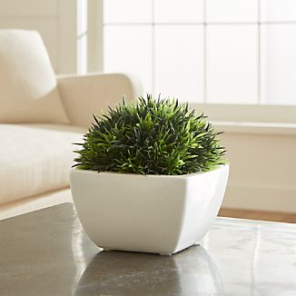 Spring sprigs in verdant green add fresh colors and lush textures to shelf or tabletop. Cluster in groups or array in a row for added impact. Chunky white stoneware base adds to its own charm.