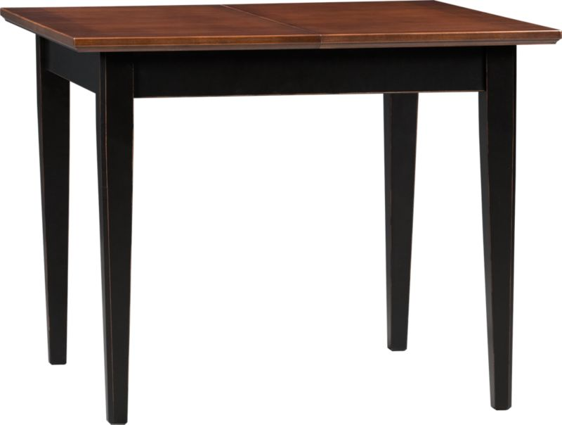"Gather around our farmhouse-inspired table for memorable meals. A hand-distressed black finish with brown undertones on the apron and clean, tapered hardwood legs suggest a relaxed refinement that moves Pranzo out of the country and into a casual dinner party for four (extension leaf seats six). Tanganyika walnut top gets its rich character from a multistage process of layering and distressing to achieve a deep, rich patina with prominent hand-brushing.<br /><br /><NEWTAG/><ul><li>Solid hardwood base with hand-distressed black finish</li><li>Tanganyika walnut veneer top over low-emission engineered wood</li><li>One 20"" extension leaf</li><li>Seats four; six with extension leaf</li></ul>"