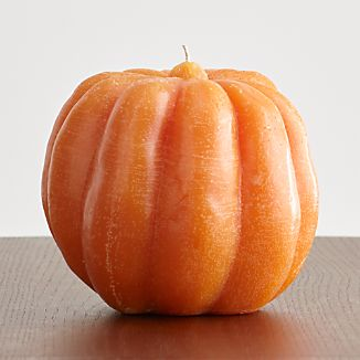 Pumpkin shaped candle has light textured finish accenting the orange color and familiar grooves of the fall pumpkin. Drip-free unscented candle is a natural addition to the holiday table or seasonal display.