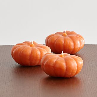 Sculpted with the pumpkin's great grooves and bright orange color, this set of three mini pumpkin candles makes a festive accent to the fall home or table.