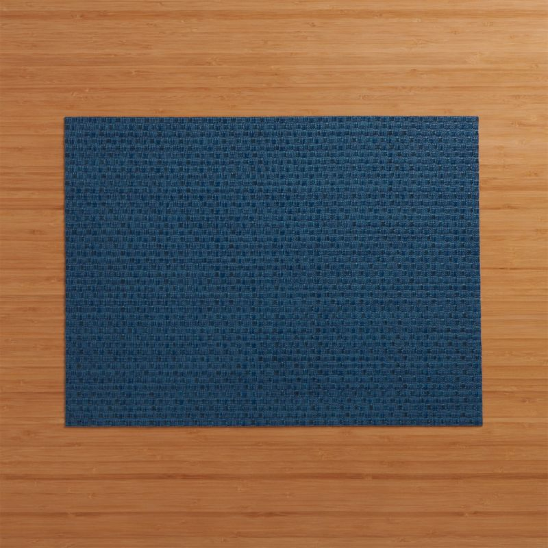 Deep blue vinyl textures the table in our exclusive Chilewich® woven placemat.<br /><br /><a href=/shop-by-brand/chilewich-placemats-doormats/1>View all Chilewich products</a><br /><br /><NEWTAG/><ul><li>100% woven vinyl</li><li>Hand wash</li><li>Made in USA</li></ul>