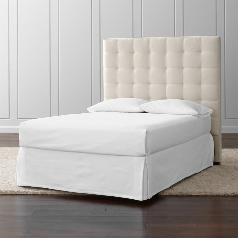"Lining up on the grid in a tall presence for the contemporary bedroom, our Quadrant full headboard is wrapped in a soft, cotton-poly blend fabric. The headboard's buttonless tufting adds casual definition and visual interest. The Quadrant Full Headboard is a Crate and Barrel exclusive.<br /><br /><NEWTAG/><ul><li>Frame is benchmade with certified sustainable hardwood that's kiln-dried to prevent warping</li><li>Soy-based polyfoam cushioning</li><li>Solid maple legs with brown finish</li><li>Headboard requires a bed frame (sold separately)</li><li>When attached to Crate and Barrel bed frame no additional hardware required; -Accommodates <a href=""/furniture/mattresses-foundations/1"">mattress and box spring</a> (sold separately)</li><li>Non-Crate and Barrel bed frame may require a Modi-Plate Kit (sold separately)</li><li>Made in USA</li></ul><br />"