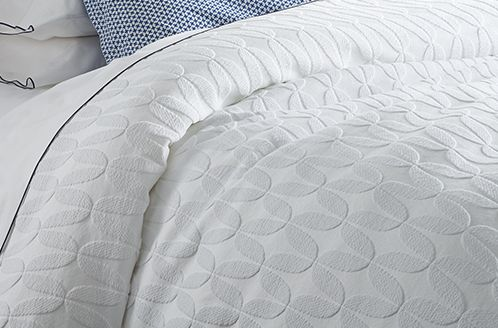 Patterned light blue bedding
