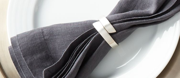 Grey napkin with napkin ring
