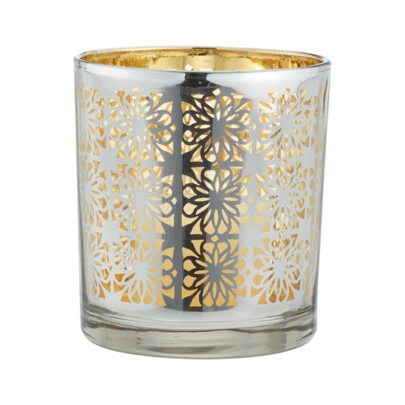 Eastern-inspired filigree is laser-cut in elaborate detail on a glass candleholder with electro-plated gold interior and silver exterior. The effect is an exotic glow when lit with a votive or tealight candle.<br /><br /><NEWTAG/><ul><li>Clear glass</li><li>Electroplate laser-cut pattern</li><li>Accommodates one standard votive or tealight candle, sold separately</li><li>Clean with a damp cloth</li><li>Made in China</li></ul>