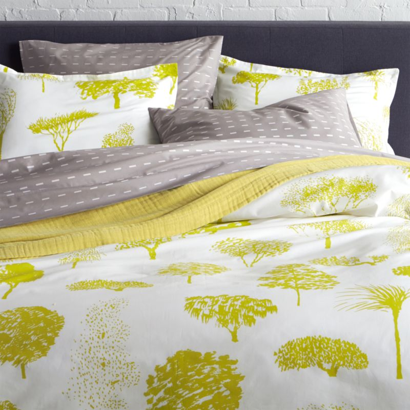 "Global forest plants citron silhouettes of the world's trees on crisp white cotton percale bedding, artfully rendered in designer Fujiwo Ishimoto's painted design. Inspired by his observations of nature in many settings, the pattern is named Rantapuisto, a Finnish word meaning ""beach park."" Reversible duvet cover has hidden button closure and interior fabric ties to keep the duvet in place. Duvet insert available.<br /><br /><NEWTAG/><ul><li>Designed by Fujiwo Ishimoto</li><li>100% cotton percale</li><li>300-thread-count</li><li>Hidden button closure and interior fabric ties</li><li>Machine wash cold, tumble dry low; warm iron as needed</li><li>Made in Pakistan</li></ul>"