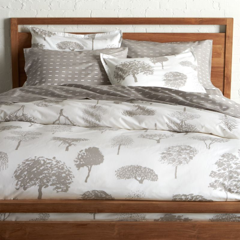 """Global forest plants grey silhouettes of the world's trees on crisp white cotton percale bedding, artfully rendered in designer Fujiwo Ishimoto's painted design. Inspired by his observations of nature in many settings, the pattern is named Rantapuisto, a Finnish word meaning """"beach park."""" Reversible duvet cover has hidden button closure and interior fabric ties to keep the duvet in place. Duvet insert available.<br /><br /><NEWTAG/><ul><li>Designed by Fujiwo Ishimoto</li><li>100% cotton percale</li><li>300-thread-count</li><li>Hidden button closure and interior fabric ties</li><li>Machine wash cold, tumble dry low; warm iron as needed</li><li>Made in Pakistan</li></ul>"""