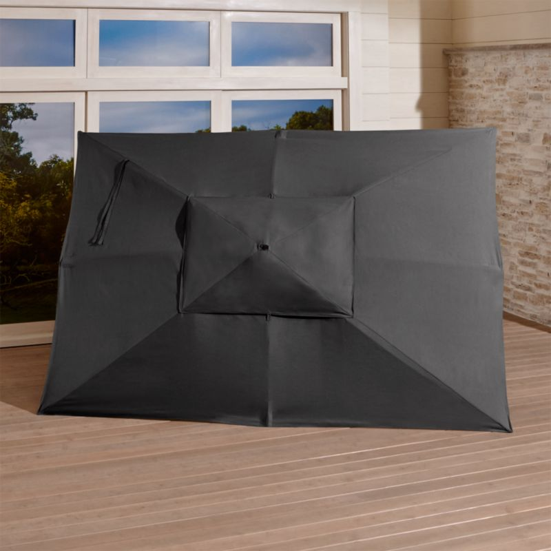 "An oversized, chic charcoal canopy of fade- and mildew-resistant Sunbrella® acrylic blocks up to 98% of the sun's UV rays. Fits all of our rectangular frames. For frame and stand options with this cover, see below (frames and stands sold separately).<br /><br /><NEWTAG/><ul><li>Cover: fade- and mildew-resistant Sunbrella acrylic umbrella (fits all our rectangular frames; spot clean)</li><li>Frames (sold separately): adjustable FSC-certified eucalyptus with solid brass pulley; or aluminum with black finish</li><li>Stands (sold separately): rustproof poly resin and stone-polyester mixture, in charcoal finish</li><li>Small stand accommodates our rectangular umbrellas with metal frames</li><li>Large stand works with any of our umbrella frames: accommodates 1.5""dia. frame with adapter, or 1.875""dia. frame without adapter</li><li>Large stand works with a table or on its own</li><li>Made in USA</li></ul>"